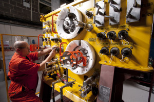 Technician working on subsea controls system