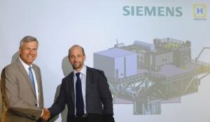 Koos-Jan van Brouwershaven, CEO HFG (l) and Andreas Barth, Head of Grid Access at Siemens (r).