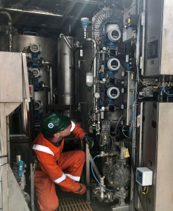 A Nature Group engineer operating one of the company's Compact Treatment Units (CTU)