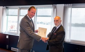 Damen CEO Mr Berkvens (left) receives a CEMT award from CEMT Chairman Mr Blakeley
