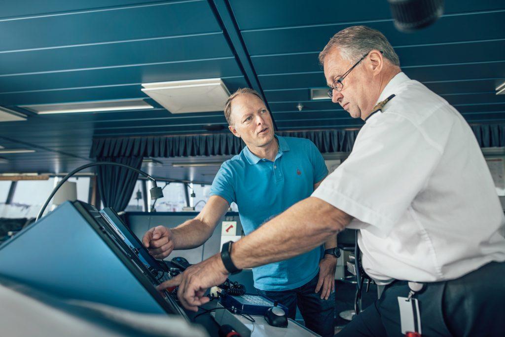 Stena Line's Head of AI Lars Carlsson and Senior Master Jan Sjöström discussing the new AI-model onboard Stena Scandinavica